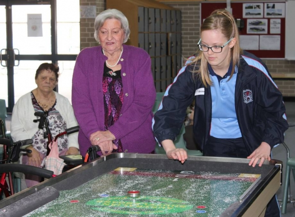 Carrington Aged Care Residents Bond with Magdalene students in shuffleboard competition